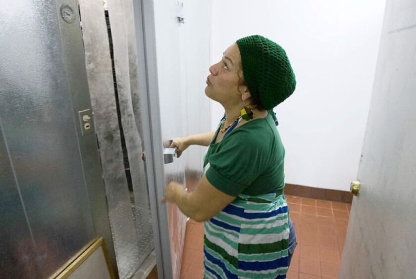 Lorrie Sanchez, the head chef at Someone Cares Soup Kitchen, looks at the new walk-in freezer in the facilities newly remodeled kitchen Monday,