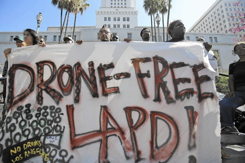 The Stop LAPD Spying Coalition holds a news conference outside L.A. City Hall in August. Gov. Brown on Sunday vetoed legislation that would have required law enforcement to obtain warrants to use drones for surveillance.