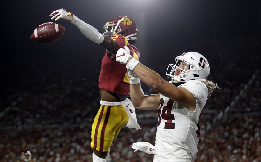 USC cornerback Olaijah Griffin, left, breaks up a pass in the end zone intended for Stanford tight end Colby Parkinson.