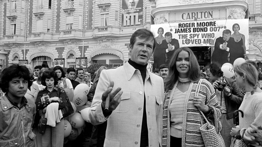 """Roger Moore with co-star Barbara Bach at the screening of 1977's """"The Spy Who Loved Me"""" at the Cannes Film Festival."""