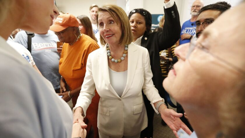 House Minority Leader Nancy Pelosi speaks to volunteers after an Oct. 17 get-out-the-vote event for Democratic candidates in Coral Gables, Fla.