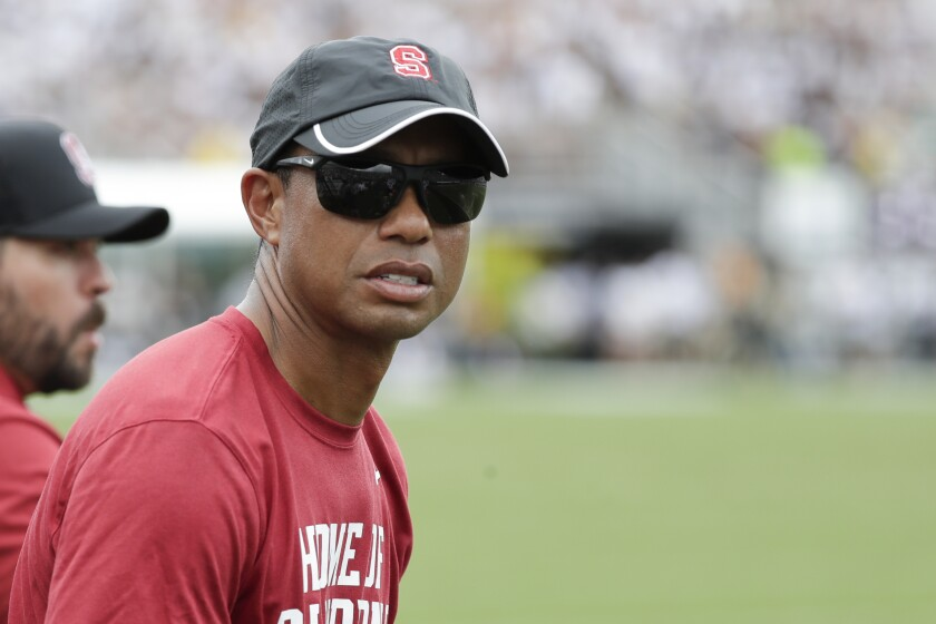 Stanford alum Tiger Woods watches the Cardinal's 45-27 loss to Central Florida in Orlando on Sept. 14, 2019.