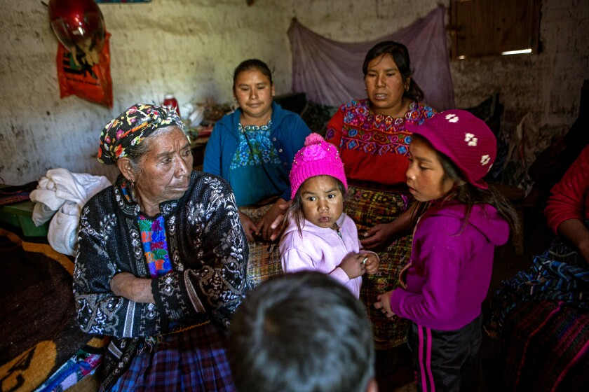 Family and neighbors of migrant Rivaldo Jimenez gather at his home in Comitancillo, Guatemala