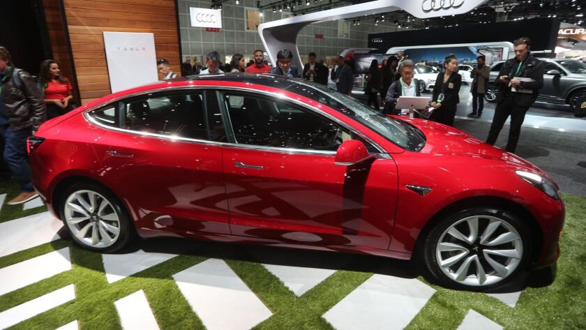 The Tesla Model 3 is displayed at the Los Angeles Auto Show in November.