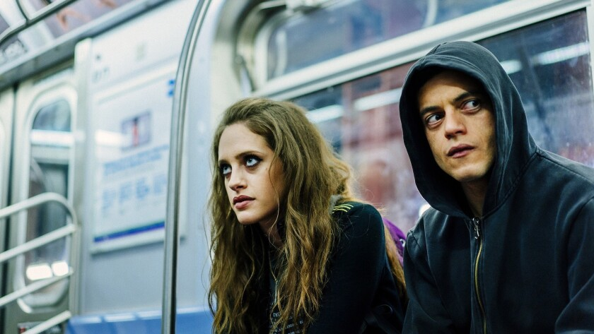 "Carly Chaikin plays Darlene and Rami Malek is Elliot Alderson on USA's ""Mr. Robot."""