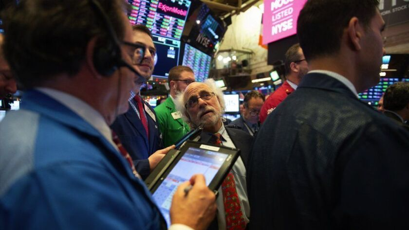 Traders work on the floor at the New York Stock Exchange on Dec. 6, 2018 in New York. Stocks were sharply lower in trading on Dec. 7.
