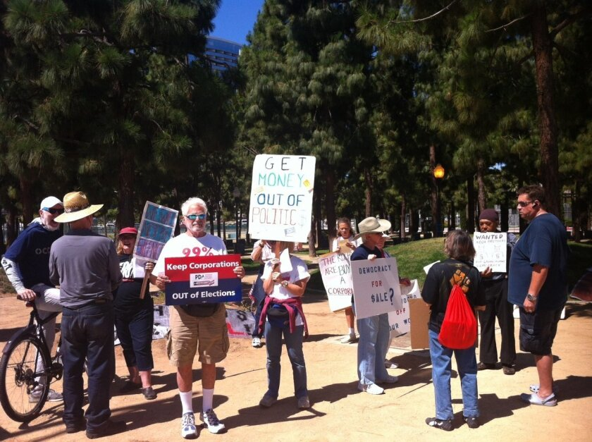 A group of protesters turned out Sunday to draw attention to the role of money in politics.