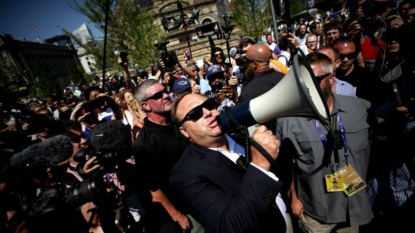 Radio host Alex Jones speaks to crowds near Quicken Loans Arena, the venue for the 2016 Republican National Convention.