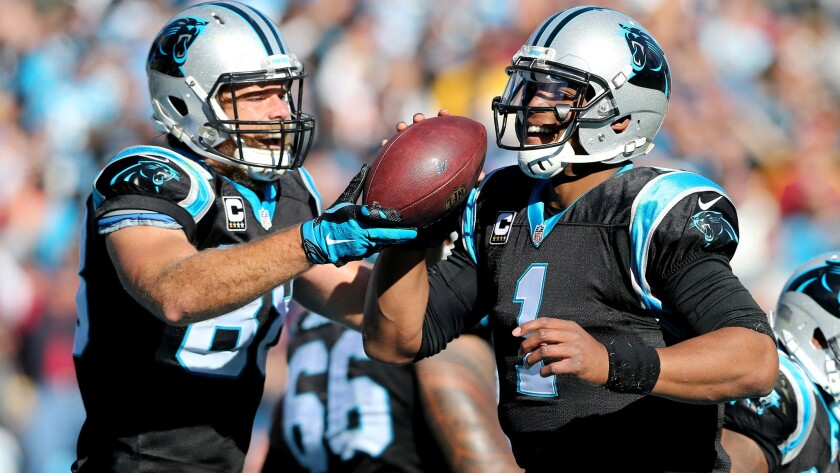 Panthers are still perfect; Cowboys win in Romo's return