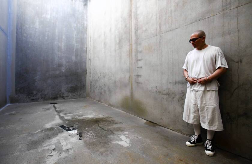 In 2013, solitary confinement inmate Javier Zubiate stands in the concrete recreation area at Pelican Bay State Prison in Northern California.