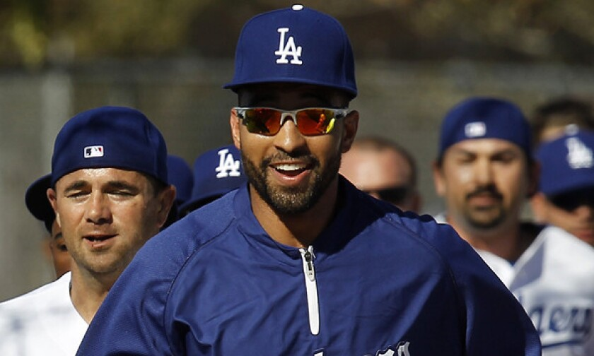 Dodgers outfielder Matt Kemp runs with his teammates at team's spring training facility in Phoenix in February 2013. Will Kemp be healthy enough to play when the season opens?