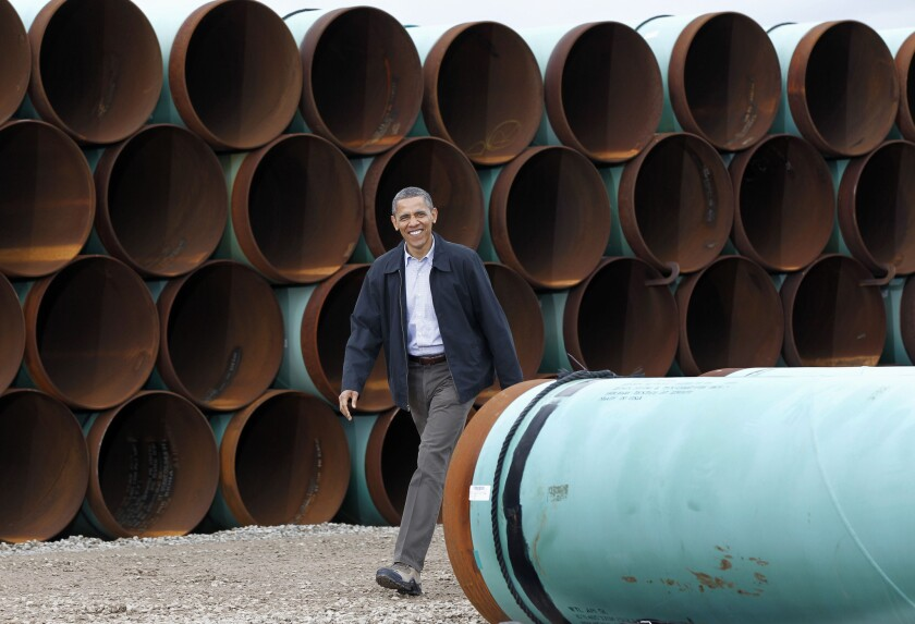 President Obama is seen arriving at the TransCanada Stillwater Pipe Yard in Cushing, Okla. in 2012.