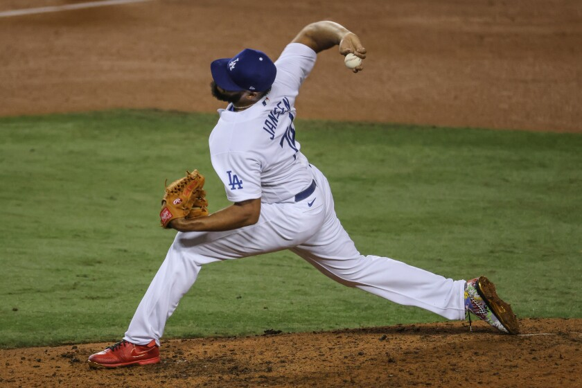 Dodgers closer Kenley Jansen delivers during the ninth inning of a 4-2 win.