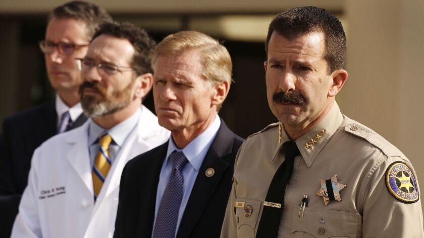 Ventura County Sheriff Bill Ayub, right, with Ventura District Attorney Gregory Totten, Ventura County Chief Medical Examiner Dr. Christopher Young and Paul Delacourt, assistant director in charge of the FBI's Los Angeles Field Office, at the Borderline shooting press conference.
