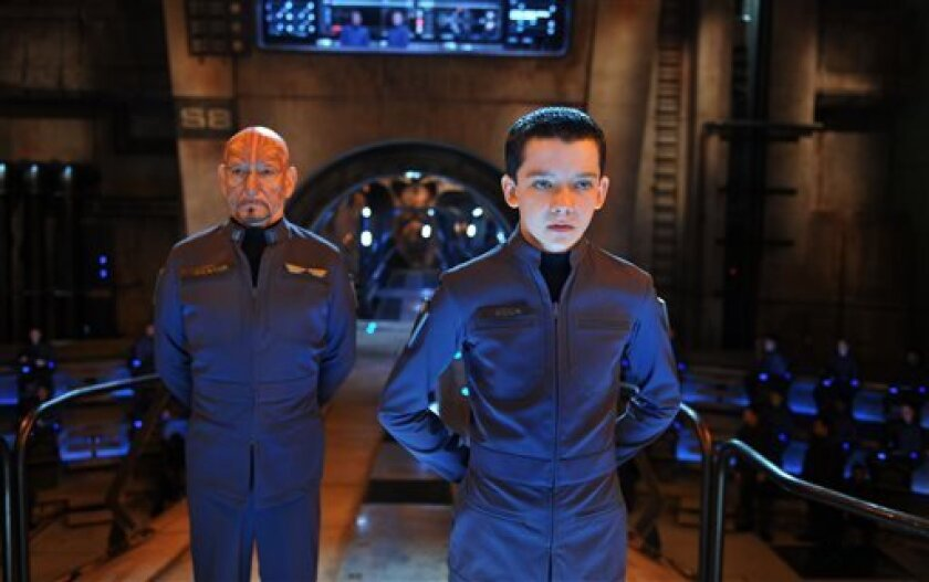 "This image released by Summit Entertainment shows Ben Kingsley, left, and Asa Butterfield in a scene from ""Ender's Game."" (AP Photo/Summit Entertainment, Richard Foreman)"