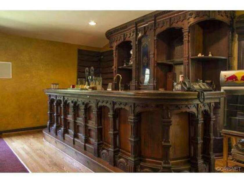 Wilmer Valderrama has put his 1946 property on the market. A carved wooden bar is among its features.