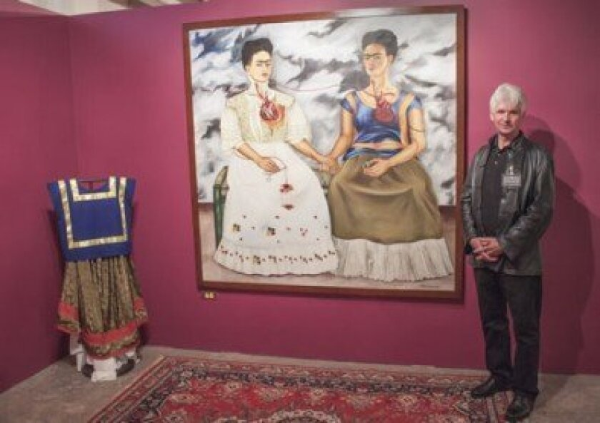 Co-Curator Hans-Jürgen Gehrke poses with 'The Two Fridas' at 'The Complete Frida Kahlo' exhibit on view at NTC Liberty Station through Jan. 19, 2014.  Maurice Hewitt