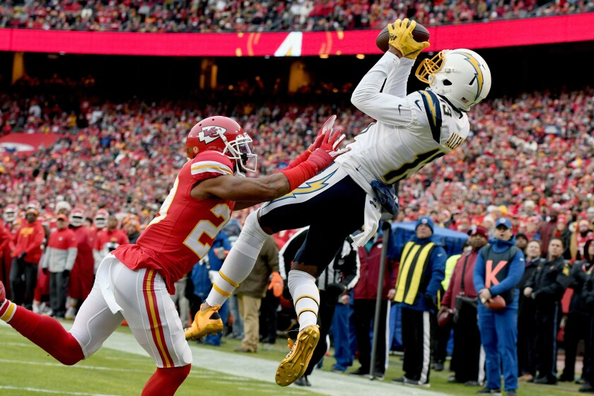 Chargers wide receiver Keenan Allen (13) makes a touchdown catch against Kansas City Chiefs cornerback Kendall Fuller (29) during the first half on Dec. 29, 2019 in Kansas City, Mo.