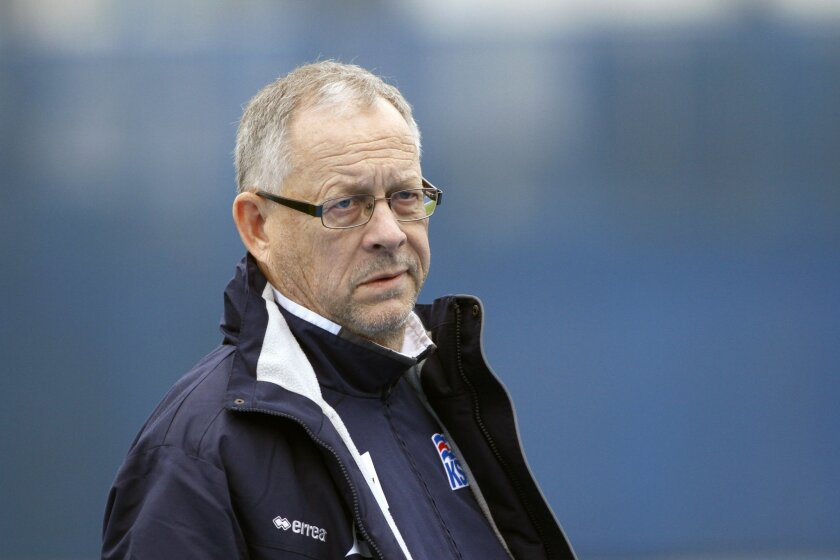 FILE - In this Monday, Nov. 18 2013 filer, Iceland's coach Lars Lagerback, leaves the  pitch after a training session at the Maksimir stadium in Zagreb, Croatia. (AP Photo/Filip Horvat, File)