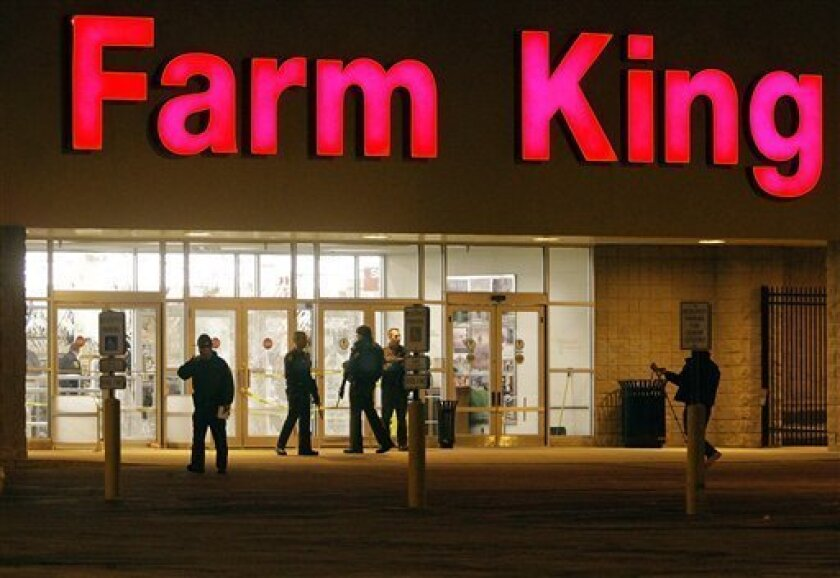 Illinois law enforcement officials stand guard outside a Farm King store in Macomb, Ill. on Wednesday, Feb. 3, 2010 after police said the suspected gunman at the western Illinois farm supply store was dead and the standoff over. (AP Photo/Seth Perlman)