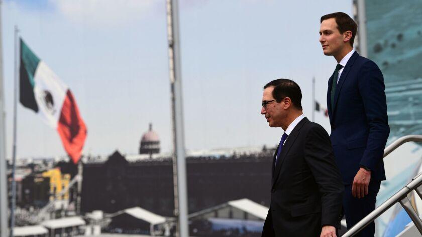 White House advisor Jared Kushner, right, and Treasury Secretary Steven T. Mnuchin arrive July 13 in Mexico City.