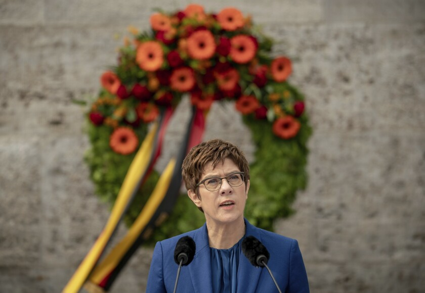 Annegret Kramp-Karrenbauer, German Minister of Defense, delivers her speech at the Ploetzense Lake Memorial in memory of those murdered in the resistance against the National Socialist tyranny in Berlin, Germany, Monday, July 20, 2020. The day commemorates the failed assassination attempt on Adolf Hitler on July 20, 1944. (Michael Kappeler/dpa via AP)