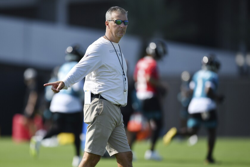 Jacksonville Jaguars head coach Urban Meyer directs players during NFL football training camp, Wednesday, July 28, 2021, at the team's practice fields outside TIAA Bank Field in Jacksonville, Fla. (Bob Self/The Florida Times-Union via AP)