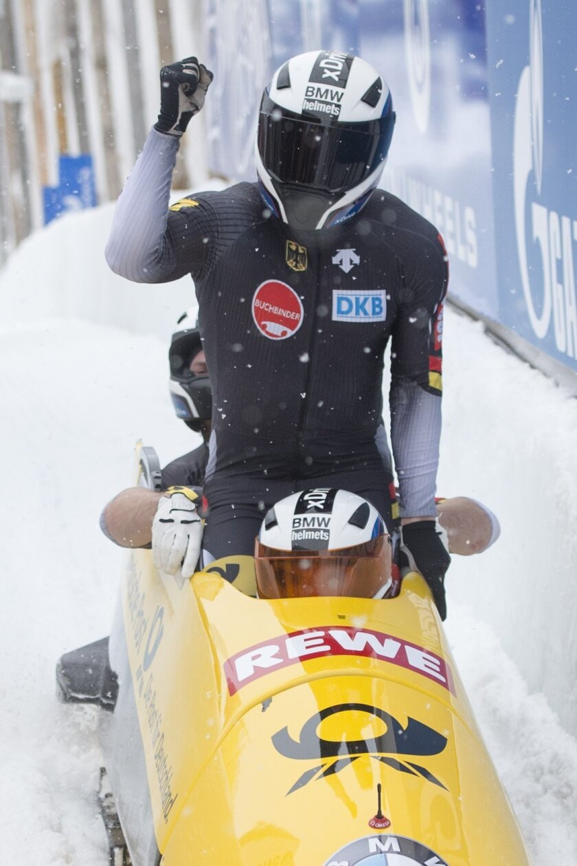 Germany's Maximilian Arndt, Kevin Korona, Martin Putze and Ben Heber arrive in the finish area  to win the men's 4-man bobsled  World Cup competition in St. Moritz, Switzerland, Sunday, Feb. 7,  2016.  (Urs Flueeler/Keystone via AP)