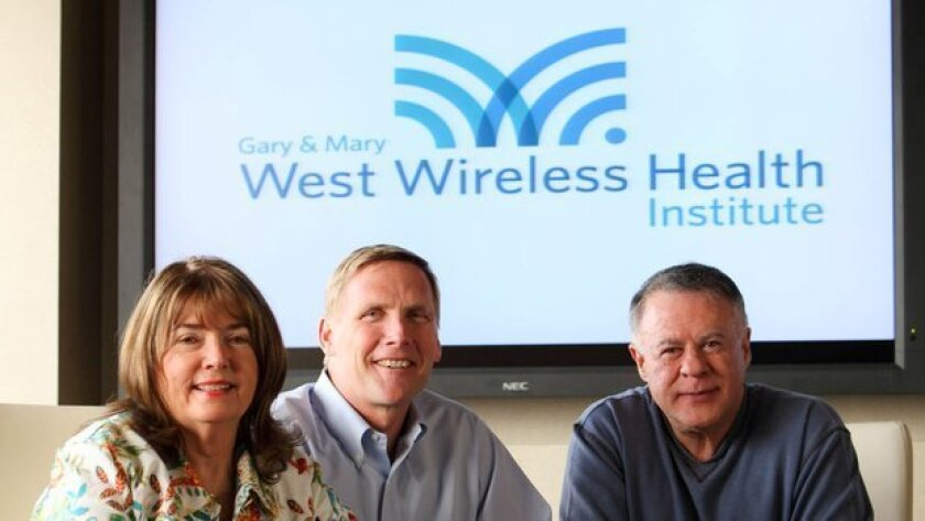 Donald Casey Jr., formerly of West Health Institute, shown at center, between funders Gary and Mary West