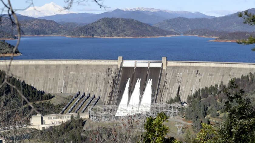 Water flows from the gates of the Shasta Dam on Jan. 12, 2017.