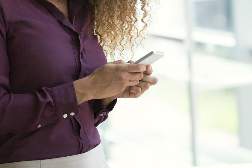 Woman uses smartphone