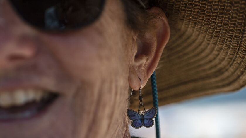 REDONDO BEACH, CA - JULY 14, 2018: Biologist Ann Dalkey wears earrings of the endangered El Segundo