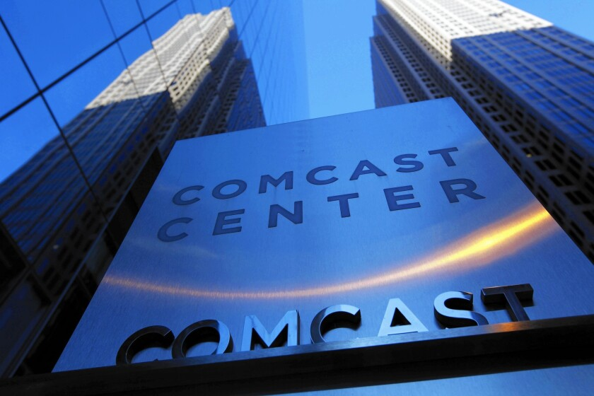 Comcast maintains the regulatory review of its Time Warner Cable acquisition is proceeding on schedule. Above, Comcast offices in Philadelphia in 2009.