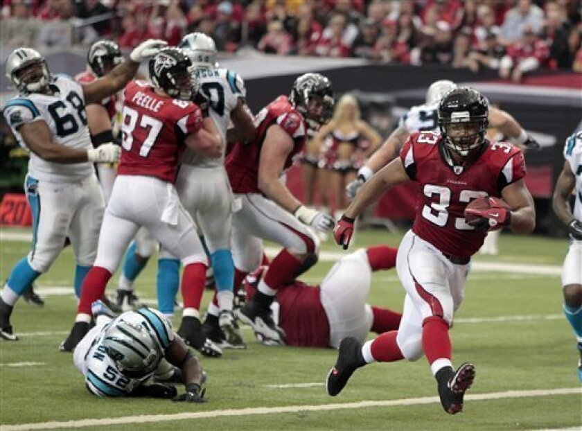 Atlanta running back Michael Turner (33) runs for a touchdown in the third quarter of an NFL football game against the Carolina Panthers Sunday, Jan. 2, 2011 in Atlanta. (AP Photo/John Bazemore)