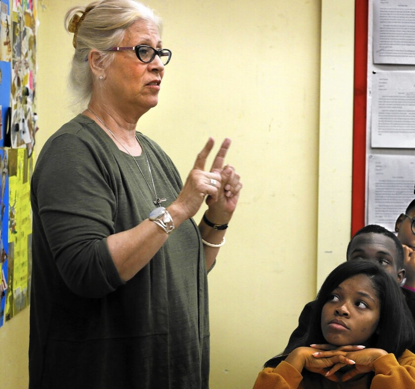 Westchester High School senior Mikayla Smith, right, and her English composition classmates listen to teacher Johanna Bernstein, who began using the restorative justice ritual last year.