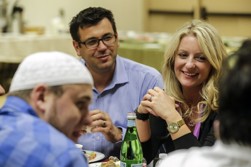 Bosniaks Cultural Community of Southern California's President Halil Hasic, center, with his wife, Selma, at an iftar party held at the Heritage Park Community Center.