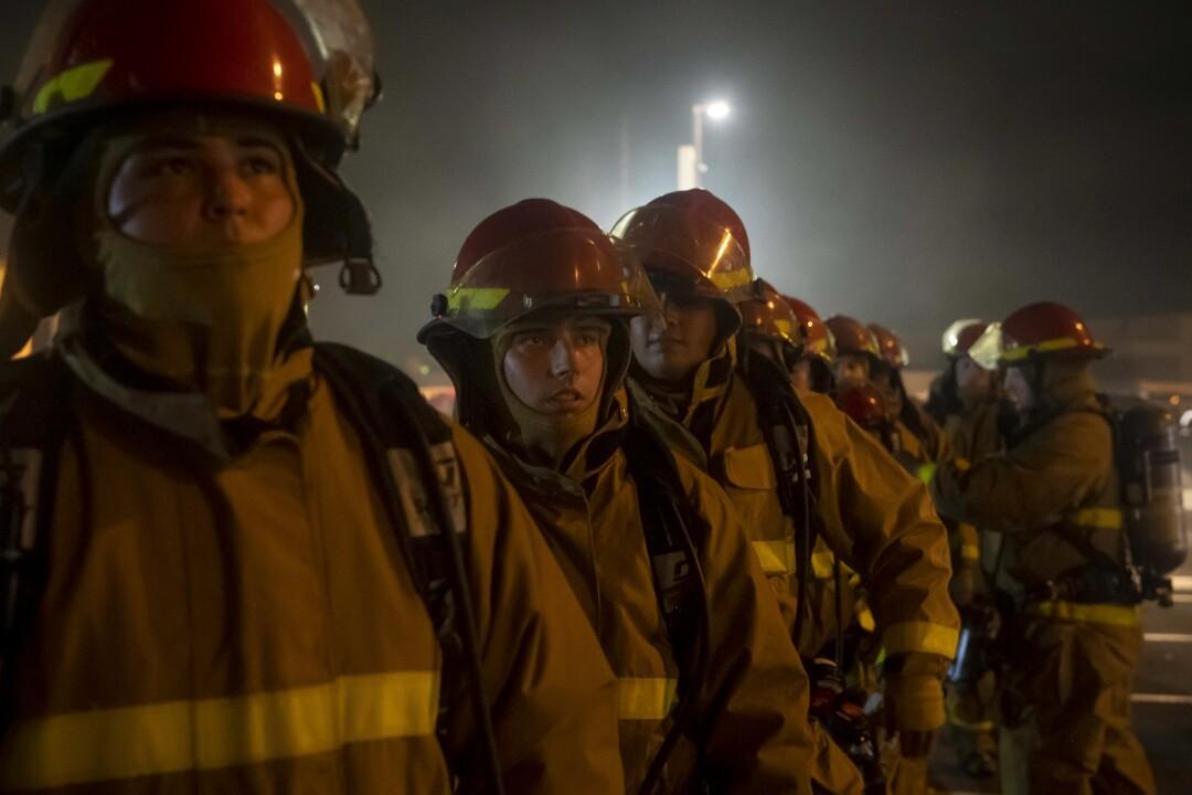Sailors prepare to fight a fire aboard the amphibious assault ship USS Bonhomme Richard.