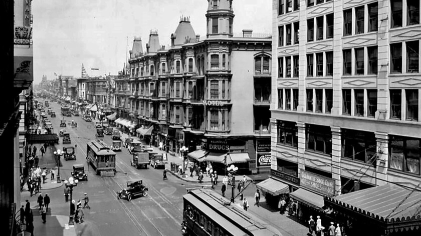The corner of 4th and Main streets in downtown L.A. in 1926. The San Fernando Building is in the foreground at right.