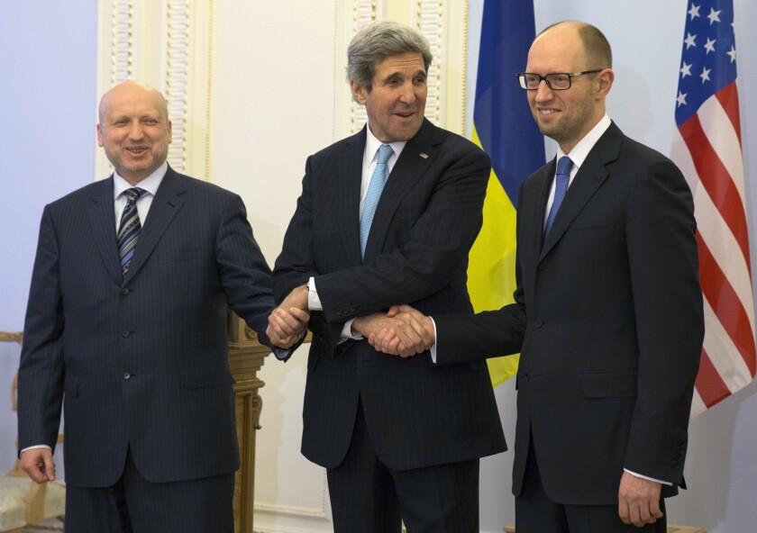 Ukraine's interim president, Oleksandr Turchynov, left, with Secretary of State John F. Kerry and interim Prime Minister Arseniy Yatsenyuk at a meeting in Kiev on Tuesday.