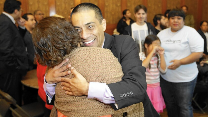 With victory in sight, Ref Rodriguez, an LAUSD District 5 candidate, hugs a supporter at his election headquarters in Highland Park.