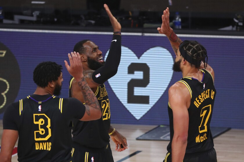 Los Angeles Lakers forward LeBron James (23) celebrates after scoring a three-point basket.