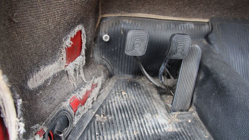 The worn but functional driver's foot box.