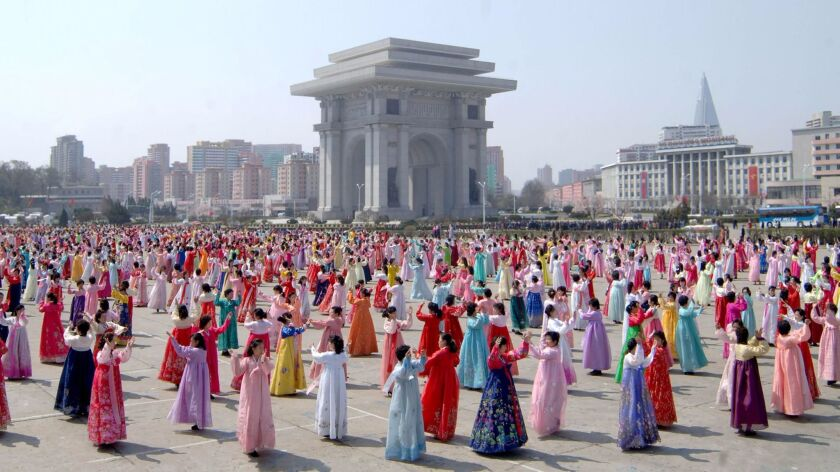People dance to celebrate the fifth anniversary of Kim Jong Un's assumption of the top posts of the