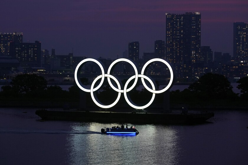 The Olympic rings float in the water at sunset in the Odaiba section in Tokyo.