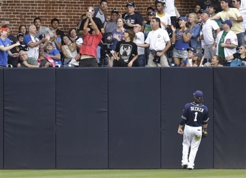 San Diego Padres left fielder Jaff Decker watches as a fan drops the catch of a home run ball hit by Chicago Cubs' Darwin Barney in the fifth inning of a baseball game, Saturday, Aug. 24, 2013, in San Diego. (AP Photo/Lenny Ignelzi)