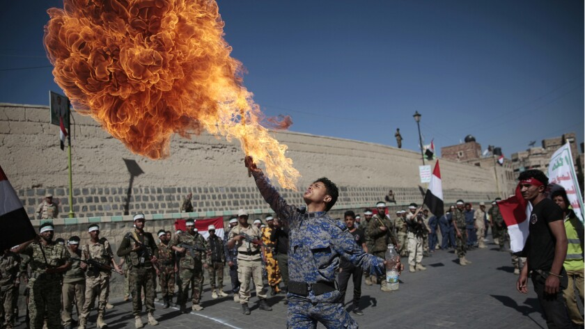 A newly recruited Shiite fighter, known as Houthi, displays his skills during a parade aimed at mobi