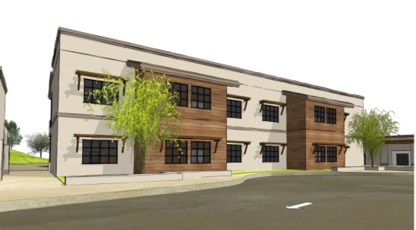 The new two-story classroom building at Solana Santa Fe School, as viewed from the parking lot and San Dieguito Road.