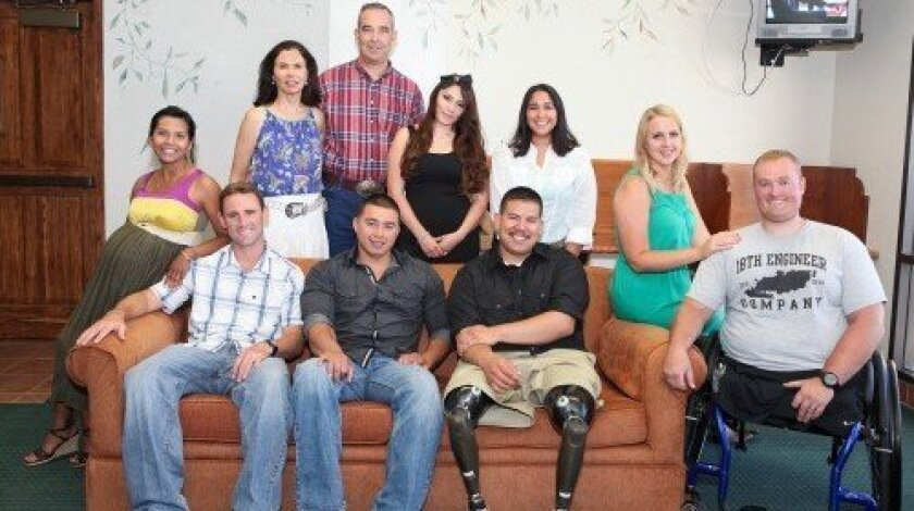 Russ and Carol Penniman with four wounded warriors and their wives at the benefit dinner/concert held recently at the Del Mar Fairgrounds. Courtesy photos