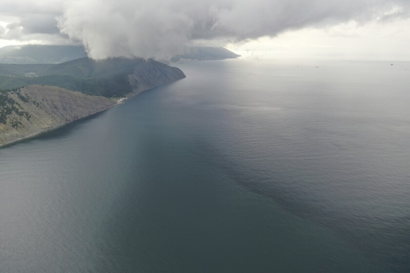 An aerial view of the Black Sea coast following an oil spill that happened while being pumped into the Minerva Symphony tanker, near Novorossiysk, Russia, Thursday, Aug. 12, 2021. Russian prosecutors have opened a criminal probe into an oil spill off the country's Black Sea coast that appeared to be far bigger than initially thought. Authorities initially estimated the spill to cover only 200 square meters, but Russian scientists said Wednesday after studying satellite images that it actually covered nearly 80 square kilometers (nearly 31 square miles). (AP Photo)