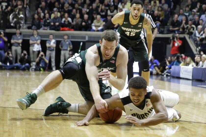 Michigan State forward Matt Costello (10) and Purdue guard P.J. Thompson (3) go for a loose ball in the first half of an NCAA college basketball game in West Lafayette, Ind., Tuesday, Feb. 9, 2016. (AP Photo/Michael Conroy)